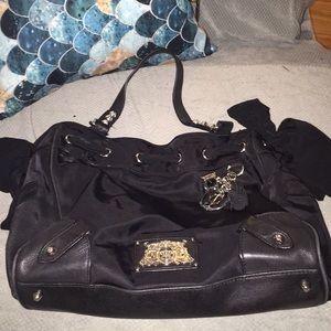 Black juicy couture purse.